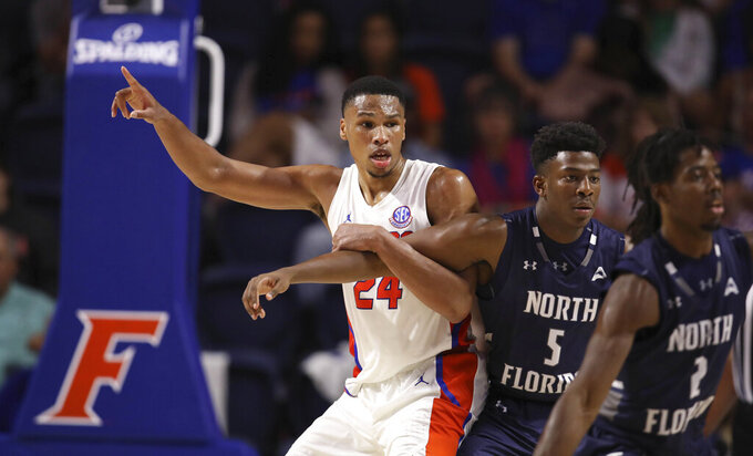 Florida forward Kerry Blackshear Jr. (24) looks for the ball against North Florida forward Dorian James (5) during the second half of an NCAA college basketball game Tuesday, Nov. 5, 2019, in Gainesville, Fla. (AP Photo/Matt Stamey)