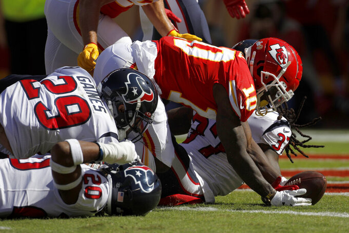 Kansas City Chiefs wide receiver Tyreek Hill (10) gets up after scoring a touchdown against Houston Texans safety Jahleel Addae (37) during the first half of an NFL football game in Kansas City, Mo., Sunday, Oct. 13, 2019. (AP Photo/Colin E. Braley)