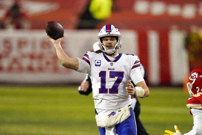 Buffalo Bills quarterback Josh Allen throws a pass during the second half of the AFC championship NFL football game against the Kansas City Chiefs, Sunday, Jan. 24, 2021, in Kansas City, Mo. (AP Photo/Charlie Riedel)
