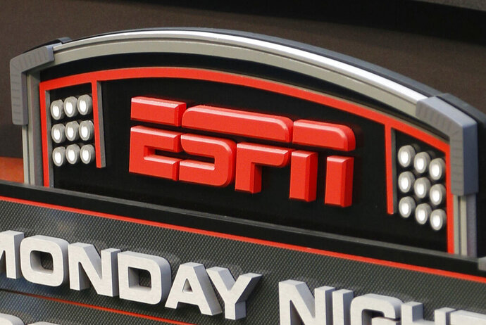 FILE - This Sept. 16, 2013, file photo shows the ESPN logo prior to an NFL football game between the Cincinnati Bengals and the Pittsburgh Steelers, in Cincinnati. ESPN is reminding employees of the network's policy to avoid talking about politics after radio talk show host Dan Le Batard criticized President Donald Trump and his recent racist comments and ESPN itself on the air this week. (AP Photo/David Kohl, File)