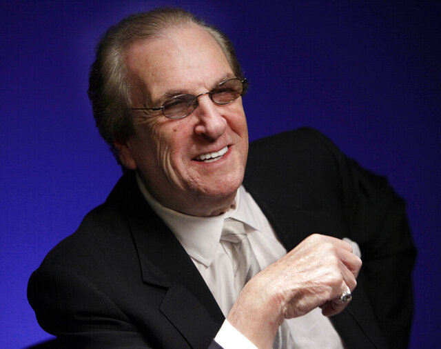 """FILE - In this Friday, Oct. 7, 2011, file photo, actor Danny Aiello smiles while being photographed in New York. Aiello, the blue-collar character actor whose long career playing tough guys included roles in """"Fort Apache, the Bronx,"""""""