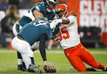 FILE - In this Aug. 23, 2018, file photo, Cleveland Browns defensive end Myles Garrett (95) takes down Philadelphia Eagles quarterback Nick Foles (9) for a safety during the first half of an NFL preseason football game in Cleveland. The New Orleans Saints' second highest-paid player on offense is left tackle Terror Armstead, who expects to have one of his tougher assignments this season against Garrett. (AP Photo/Ron Schwane, File)