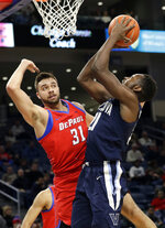 Villanova forward Dhamir Cosby-Roundtree, right, shoots against DePaul guard Max Strus during the first half of an NCAA college basketball game Wednesday, Jan. 30, 2019, in Chicago. (AP Photo/Nam Y. Huh)