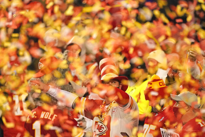 Kansas City Chiefs fans celebrate after the AFC championship NFL football game between the Chiefs and the Buffalo Bills, Sunday, Jan. 24, 2021, in Kansas City, Mo. The Chiefs won 38-24. (AP Photo/Charlie Riedel)
