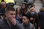 Students react as they gather outside the Perm State University in Perm, about 1,100 kilometers (700 miles) east of Moscow, Russia, Monday, Sept. 20, 2021. A gunman opened fire in a university in the Russian city of Perm on Monday morning, leaving at least eight people dead and others wounded, according to Russia's Investigative Committee. (AP Photo)
