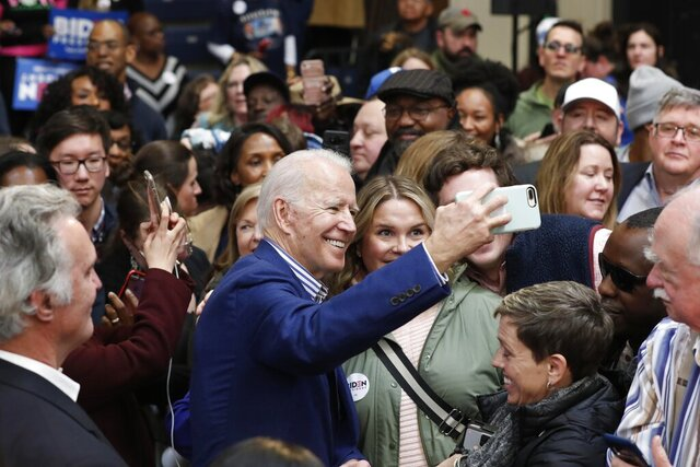 Democratic presidential candidate former Vice President Joe Biden takes photos with supporters at a campaign event at Saint Augustine's University in Raleigh, N.C., Saturday, Feb. 29, 2020. (AP Photo/Gerry Broome)
