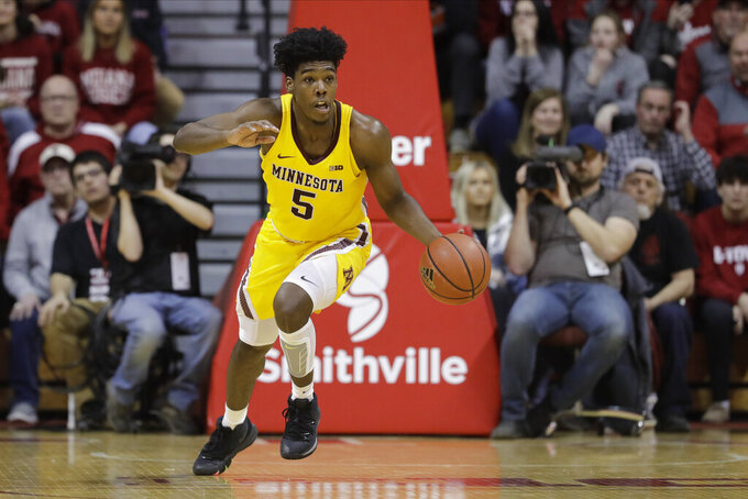 FILE - Minnesota's Marcus Carr (5) dribbles during the second half of an NCAA college basketball game against Indiana, Wednesday, March 4, 2020, in Bloomington, Ind. The Gophers will again try to bounce back from a bad season after finishing in 12th place in the Big Ten in 2019-20.(AP Photo/Darron Cummings, File)