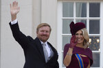 Dutch King Willem-Alexander and Queen Maxima wave from the balcony of royal palace Noordeinde in The Hague, Netherlands, Tuesday, Sept. 17, 2019, after a ceremony marking the opening of the parliamentary year with a speech by King Willem-Alexander outlining the government's budget plans for the year ahead. (AP Photo/Peter Dejong)