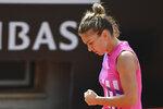 Simona Halep reacts during the quarterfinal match against Yulia Putintseva at the Italian Open tennis tournament, in Rome, Saturday, Sept. 19, 2020. (Alfredo Falcone/LaPresse via AP)