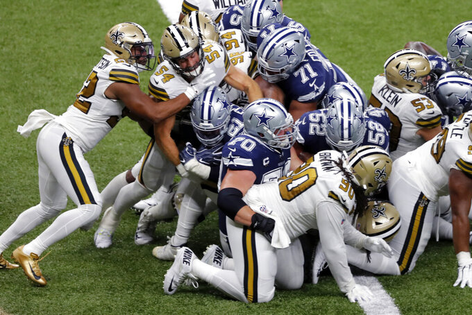 Dallas Cowboys running back Ezekiel Elliott (21) carries into the end zone for a touchdown in the second half of an NFL football game against the Dallas Cowboys in New Orleans, Sunday, Sept. 29, 2019. (AP Photo/Bill Feig)
