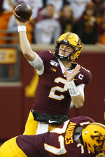 FILE - In this Oct. 5, 2019, file photo, Minnesota quarterback Tanner Morgan (2) passes against Illinois in the second half of an NCAA college football game, in Minneapolis. Penn State (8-0) plays against Minnesota (8-0)  on Saturday, Nov. 9. (AP Photo/Bruce Kluckhohn, File)