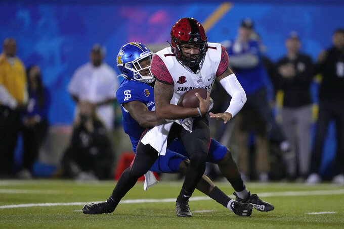 San Diego State quarterback Lucas Johnson (7) is sacked by San Jose State safety Jay Lenard (27) during the second half of an NCAA college football game, Friday, Oct. 15, 2021, in San Jose, Calif. (AP Photo/Tony Avelar)