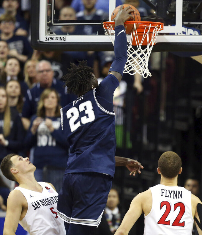 Utah State's Neemias Queta (23) dunks during the second half of an NCAA college basketball game against San Diego State for the Mountain West Conference men's tournament championship Saturday, March 7, 2020, in Las Vegas. (AP Photo/Isaac Brekken)