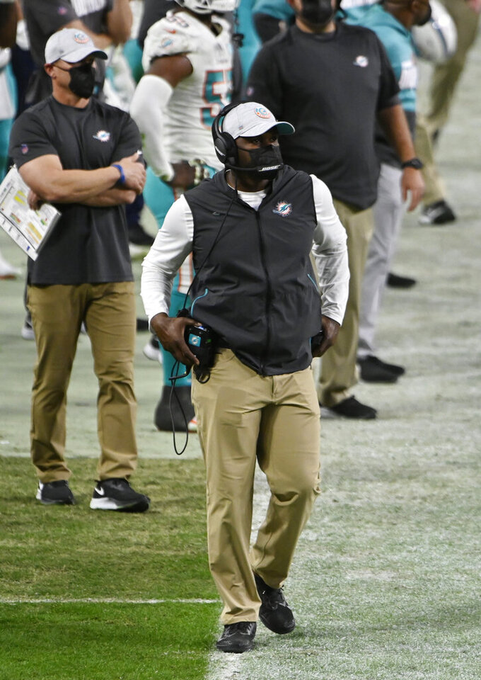 Miami Dolphins head coach Brian Flores stands on the sidelines during the second half of an NFL football game against the Las Vegas Raiders, Saturday, Dec. 26, 2020, in Las Vegas. (AP Photo/David Becker)