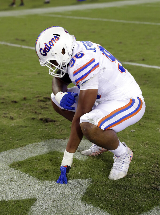 Florida defensive lineman Cece Jefferson (96) takes a moment after losing to Georgia in an NCAA college football game Saturday, Oct. 27, 2018, in Jacksonville, Fla. (AP Photo/John Raoux)