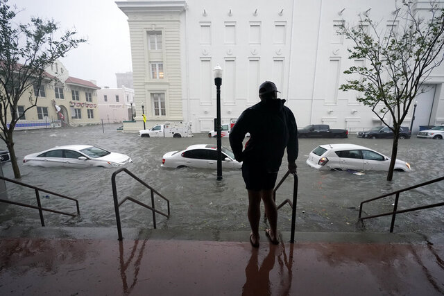 FILE - Floodwaters move on the street, Wednesday, Sept. 16, 2020, in Pensacola, Fla.  The Census Bureau is contending with several natural disasters as wildfires and hurricanes disrupt the final weeks of the nation's once-a-decade headcount. (AP Photo/Gerald Herbert)