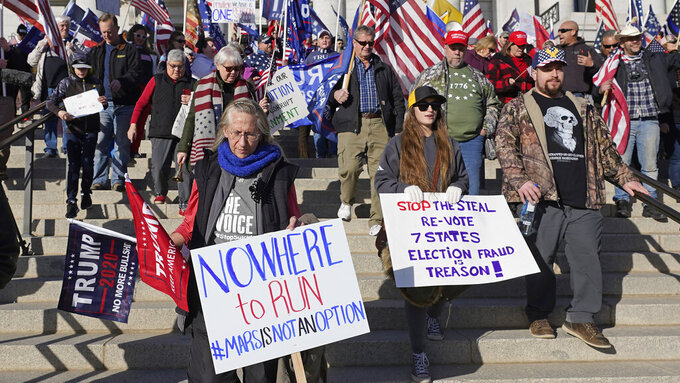 FILE - In this Jan. 6, 2021 file photo, supporters of President Donald Trump attend a rally in protest of President-elect Joe Biden election win,  in Salt Lake City. Statehouses where Trump loyalists have rallied since the Nov. 3 election are heightening security after the storming of the U.S. Capitol this week. Police agencies in a number of states are monitoring threats of violence as legislatures return to session and as the nation prepares for the inauguration of President-elect Joe Biden.   (AP Photo/Rick Bowmer, File)