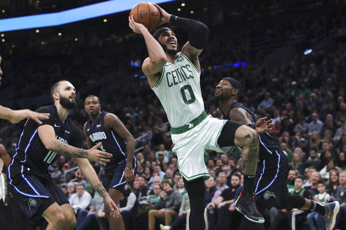 Boston Celtics forward Jayson Tatum (0) drives to the basket against the Orlando Magic during the second quarter of an NBA basketball game in Boston, Wednesday, Feb. 5, 2020. (AP Photo/Charles Krupa)