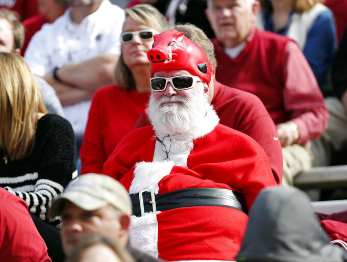 "A ""Santa Hog"" watches Arkansas play Mississippi State during the first half of an NCAA college football game in Starkville, Miss., Saturday, Nov. 17, 2018. (AP Photo/Rogelio V. Solis)"