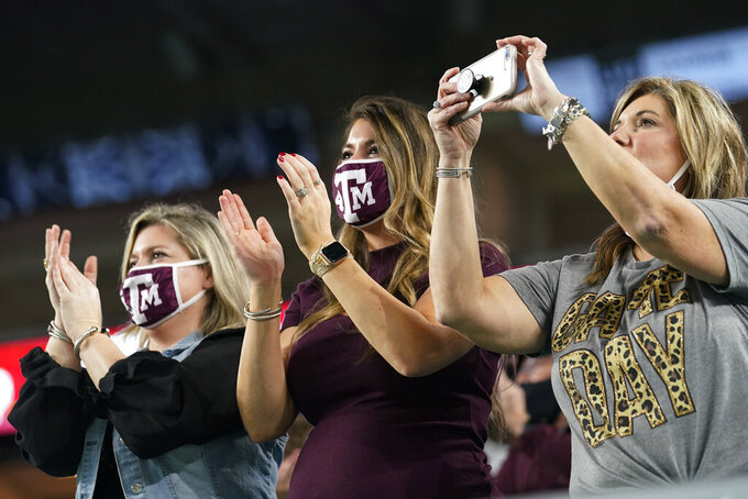 Texas A&M fans cheer during the first half of the Orange Bowl NCAA college football game against North Carolina, Saturday, Jan. 2, 2021, in Miami Gardens, Fla. (AP Photo/Marta Lavandier)