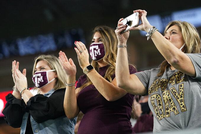 Texas A&M fans cheer during the first half of the Orange Bowl NCAA college football game against North Carolina, Saturday, Jan. 2, 2021, in Miami Gardens, Fla. (AP Photo/Marta Lavandier)