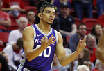 Kansas State's Mike McGuirl celebrates after making a three-point basket against UNLV during overtime of an NCAA college basketball game Saturday, Nov. 9, 2019, in Las Vegas. (AP Photo/John Locher)