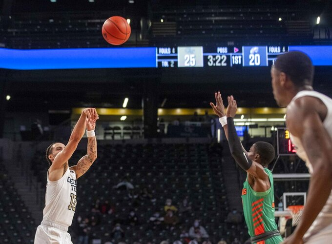 Georgia Tech guard Jose Alvarado (10) sinks a three-point basket against Florida A&M during the first half of an NCAA college basketball game in Atlanta, Friday, Dec. 18, 2020. (Alyssa Pointer/Atlanta Journal-Constitution via AP)