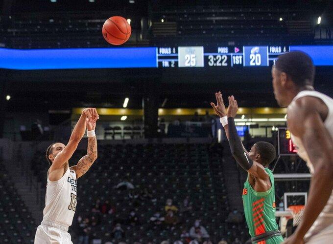 Georgia Tech guard Jose Alvarado (10) sinks a three-point basket against Florida A&M during the first half of an NCAA college basketball game in Atlanta, Friday, Dec. 18, 2020. (Alyssa Pointer/Atlanta Journal-Constitution via AP)