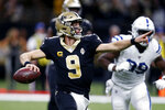 CORRECTS SECOND SENTENCE REFERENCE TO COMPLETIONS TO 27TH PASS OF THE GAME ON 28 ATTEMPTS New Orleans Saints quarterback Drew Brees (9) scrambles to pass in the first half of an NFL football game against the Indianapolis Colts in New Orleans, Monday, Dec. 16, 2019. The completion was also Brees' 27th of the game on 28 passing attempts. (AP Photo/Butch Dill)