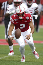 Nebraska quarterback Adrian Martinez (2) recovers a bad snap during the first half of an NCAA college football game against South Alabama, in Lincoln, Neb., Saturday, Aug. 31, 2019. (AP Photo/Nati Harnik)