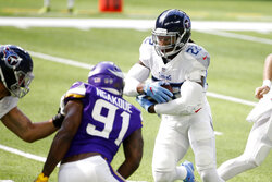 Tennessee Titans running back Derrick Henry (22) runs from Minnesota Vikings defensive end Yannick Ngakoue (91) during the first half of an NFL football game, Sunday, Sept. 27, 2020, in Minneapolis. (AP Photo/Bruce Kluckhohn)