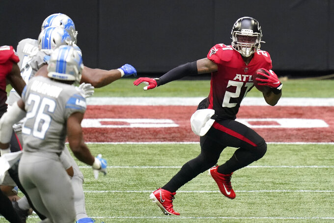 Atlanta Falcons running back Todd Gurley (21) runs against the Detroit Lions during the first half of an NFL football game, Sunday, Oct. 25, 2020, in Atlanta. (AP Photo/Brynn Anderson)