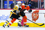 Pittsburgh Penguins' Teddy Blueger, left and Philadelphia Flyers' Jakub Voracek battle for the puck during the third period of an NHL hockey game, Tuesday, May 4, 2021, in Philadelphia. (AP Photo/Matt Slocum)