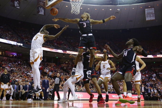 Texas guard Courtney Ramey, left, is blocked by Texas Tech guard Jahmi'us Ramsey (3) as he tries to score during the second half of an NCAA college basketball game, Saturday, Feb. 8, 2020, in Austin, Texas. Texas Tech won 62-57. (AP Photo/Eric Gay)