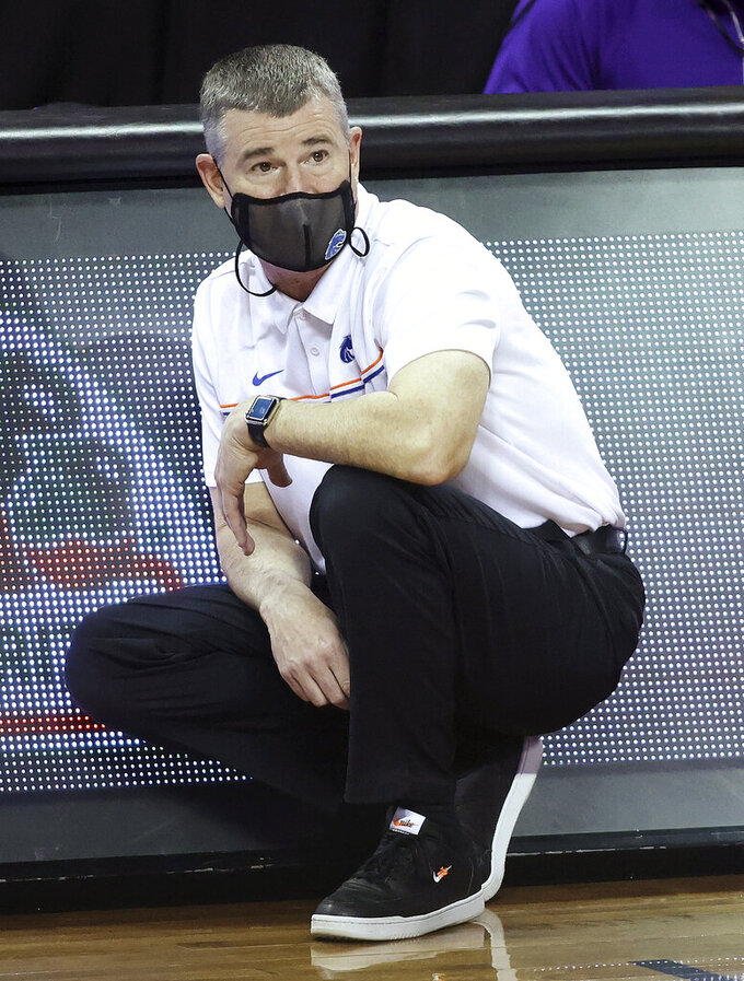 Boise State coach Leon Rice watches the team during the second half of an NCAA college basketball game against Nevada in the quarterfinals of the Mountain West Conference men's tournament Thursday, March 11, 2021, in Las Vegas. (AP Photo/Isaac Brekken)