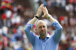 FILE - In this June 9, 2019, file photo, United States head coach Gregg Berhalter responds to fans after an international friendly soccer match against the Venezuela, in Cincinnati. The sporting director of the U.S. Soccer Federation says Gregg Berhalter's job is safe as men's national team coach despite some disappointing results.