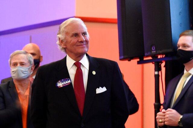 South Carolina Gov. Henry McMaster listens as Sen. Lindsey Graham, R-S.C., speaks Tuesday, Nov. 3, 2020, after winning re-election, in Columbia, S.C. (AP Photo/Meg Kinnard)