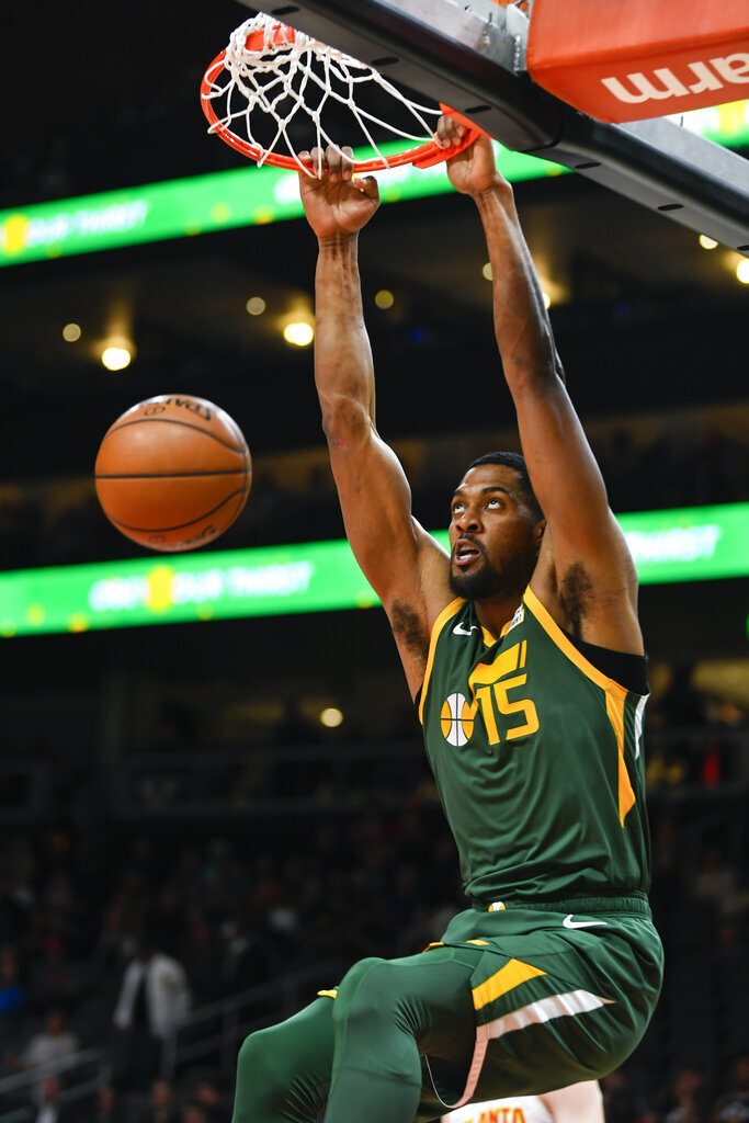 Utah Jazz forward Derrick Favors dunks during the first half of an NBA basketball game against the Atlanta Hawks, Thursday, March 21, 2019, in Atlanta. (AP Photo/John Amis)