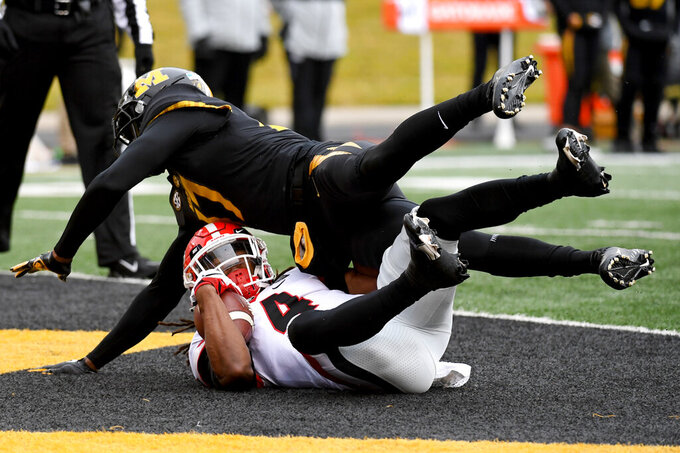 Georgia running back James Cook (4) scores as Missouri defensive back Jaylon Carlies defends during the first half of an NCAA college football game Saturday, Dec. 12, 2020, in Columbia, Mo. (AP Photo/L.G. Patterson)