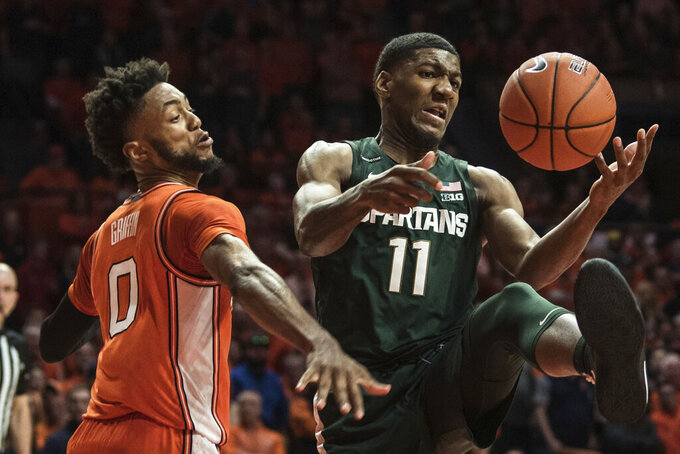 Michigan State's Aaron Henry (11) battles Illinois' Alan Griffin (0) for the loose ball in the second half of an NCAA college basketball game Tuesday, Feb. 11, 2020, in Champaign, Ill. (AP Photo/Holly Hart)