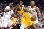 Los Angeles Lakers forward LeBron James (23) drives in front of Houston Rockets center Clint Capela (15) and forward PJ Tucker during the first half of an NBA basketball game Saturday, Jan. 18, 2020, in Houston. (AP Photo/Michael Wyke)