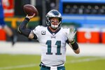 Philadelphia Eagles' Carson Wentz warms up before an NFL football game against the Green Bay Packers Sunday, Dec. 6, 2020, in Green Bay, Wis. (AP Photo/Matt Ludtke)