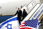 U.S. Vice President Mike Pence and his wife Karen disembark from a plane upon their arrival at Ben Gurion International Airport to attend the World Holocaust Forum at the Yad Vashem memorial centre, near Tel Aviv, Israel, Thursday, Jan. 23, 2020. (Ammar Awad/Pool Photo via AP)