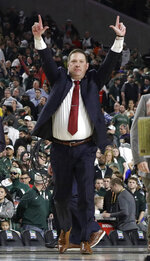 Texas Tech head coach Chris Beard celebrates at the end of a semifinal round game against Michigan State in the Final Four NCAA college basketball tournament, Saturday, April 6, 2019, in Minneapolis. (AP Photo/David J. Phillip)