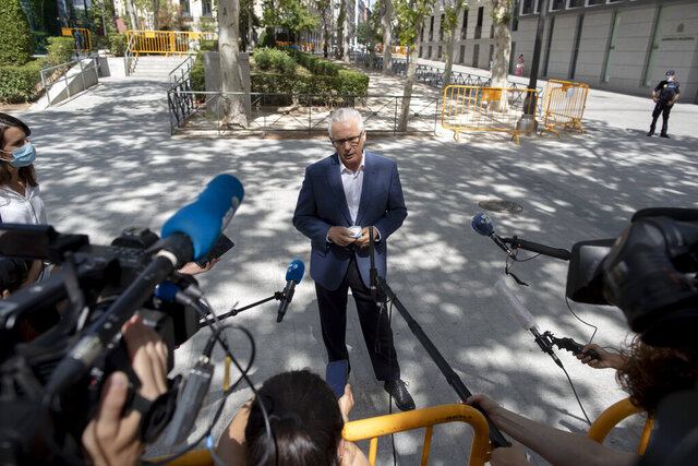 Spanish lawyer Baltasar Garzon, who is part of Assange's legal team, addresses the media after leaving the Spain's National Court in Madrid, Spain, Monday, July 27, 2020. Spain's National Court is due to hear testimony Monday in an investigation into whether a Spanish company was hired to spy on Julian Assange during the seven years the Wikileaks founder spent in the Ecuadorean Embassy in London. (AP Photo/Manu Fernandez)