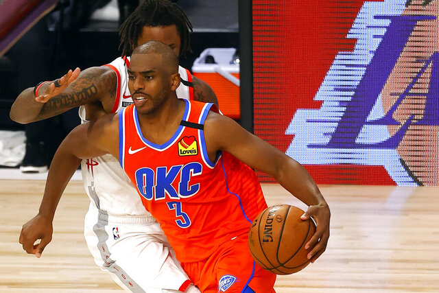 FILE - In this Aug. 22, 2020, file pool photo, Oklahoma City Thunder's Chris Paul (3) drives against the Houston Rockets during the third quarter of Game 3 of an NBA basketball first-round playoff series in Lake Buena Vista, Fla. Veteran point guard Chris Paul was the marquee addition during the offseason for the Phoenix Suns. (Mike Ehrmann/Pool Photo via AP, File)