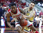North Carolina State's Markell Johnson (11) drives around Georgia Tech's Jose Alvarado (10) during the first half of an NCAA college basketball game in Raleigh, N.C., Wednesday, March, 6, 2019. (Ethan Human/The News & Observer via AP)