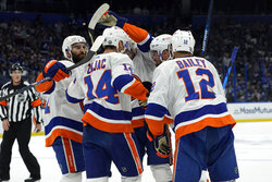 New York Islanders players celebrate a goal by Brock Nelson during the first period in Game 2 of an NHL hockey Stanley Cup semifinal playoff series against the Tampa Bay Lightning Tuesday, June 15, 2021, in Tampa, Fla. (AP Photo/Chris O'Meara)