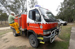 A volunteer firefighter prepares a truck as they plan their defense against the fire near Towamba, Australia, Friday, Jan. 10, 2020. The wildfires have destroyed more than 2,000 homes and continue to burn, threatening to flare up again as temperatures rise. (AP Photo/Rick Rycroft)
