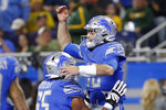 Detroit Lions quarterback David Blough is lifted by teammate offensive tackle Tyrell Crosby (65) after scoring on a 19-yard reception during the first half of an NFL football game against the Green Bay Packers, Sunday, Dec. 29, 2019, in Detroit. (AP Photo/Rick Osentoski)
